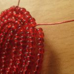 Плетемо пелюстки гібіскуса з бісеру