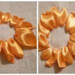 Вишиті пелюстки соняшника стрічками