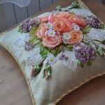 Подушка вишита стрічками і декорована шнурком