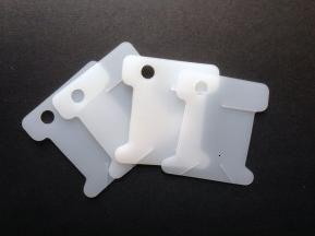 Пластикові бобіни для намотування і зберігання ниток муліне